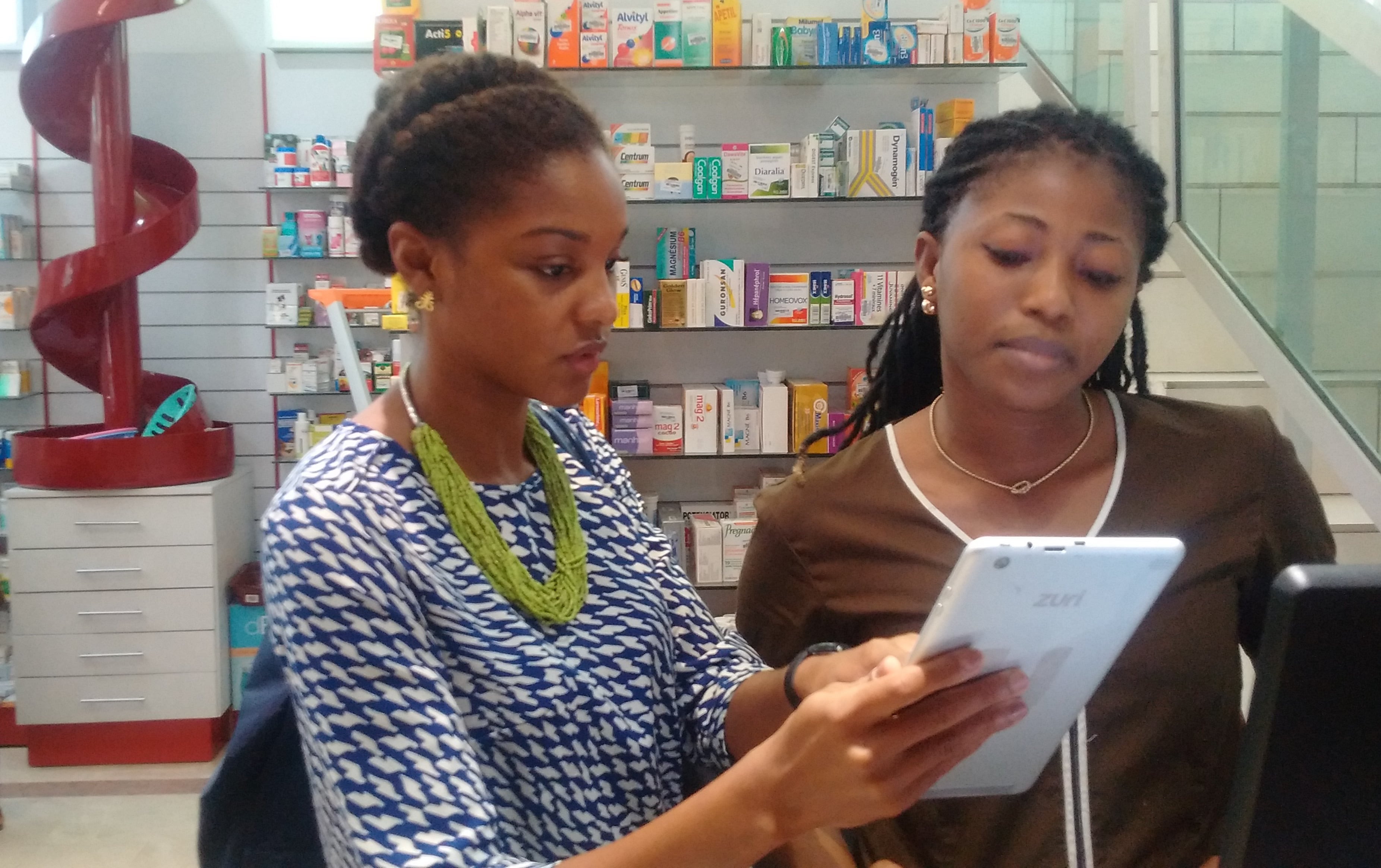 Elsie Sowah of mPharma Digital Healthcare platform, trains a pharmacist